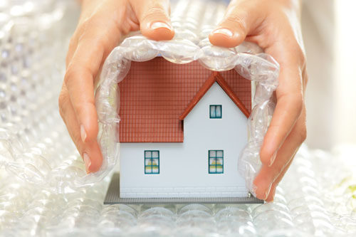 Home insurance house wrapped in bubblewrap