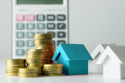 Income Protection image with coins and houses